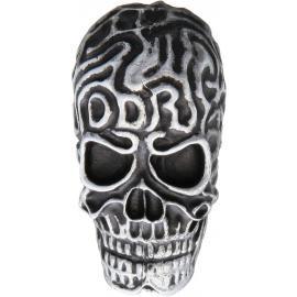 Cranio in metallo scolpito